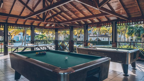 Billiard room with wooden ceiling in hotel