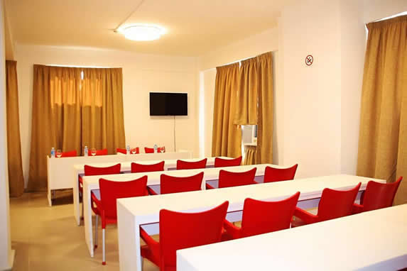 meeting room with furniture and curtains