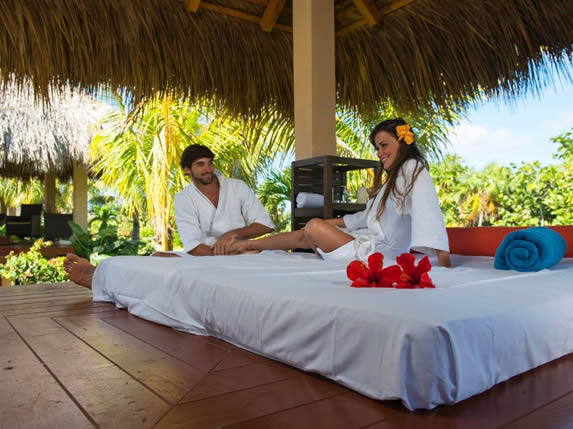 spa with massage bed under a guano roof
