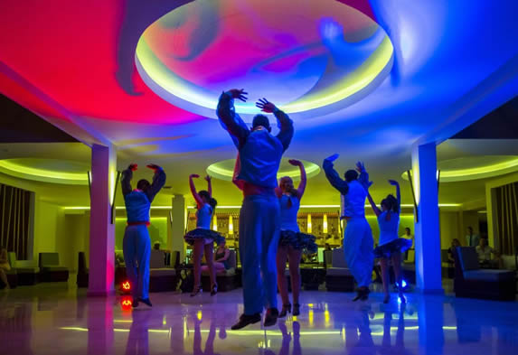 dancers on stage with colored lights