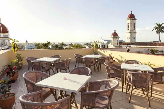 terrace with wicker furniture and beautiful view