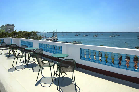 terrace with outdoor furniture and bay view