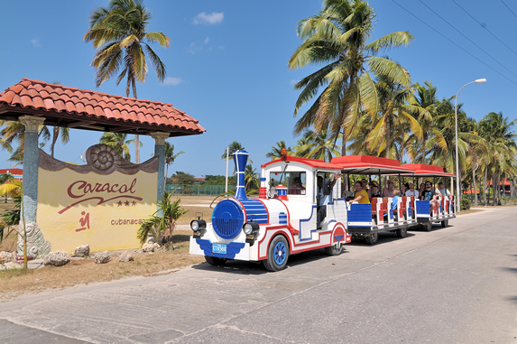 train with tourists on board at the hotel entrance