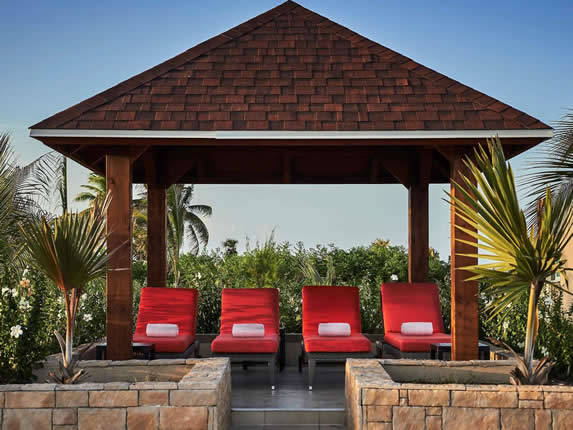 red deck chairs under tile roof