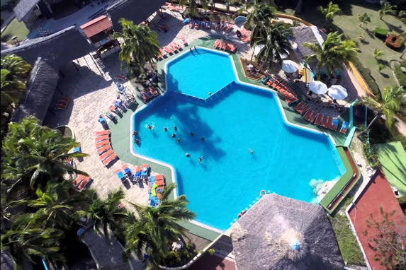 aerial view of the pool surrounded by sun loungers