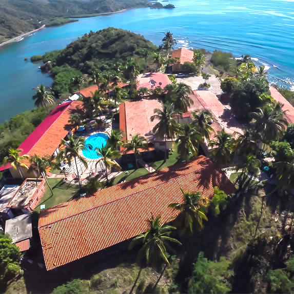 aerial view of the hotel surrounded by sea