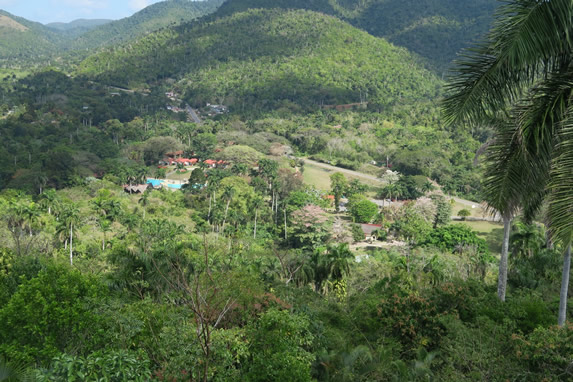aerial view of the hotel between mountains and veg