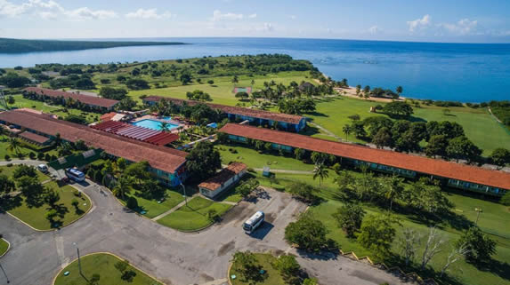 aerial view of the hotel with sea and vegetation