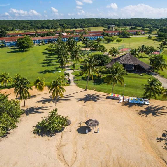 aerial view of the hotel with sand and vegetation