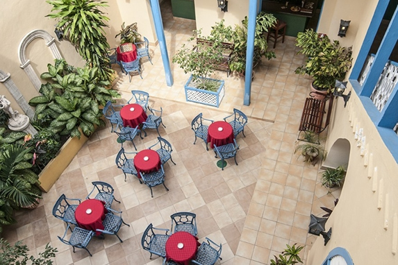 courtyard with blue chairs and tables